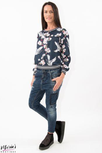 Jeans cu rupturi mici peticite